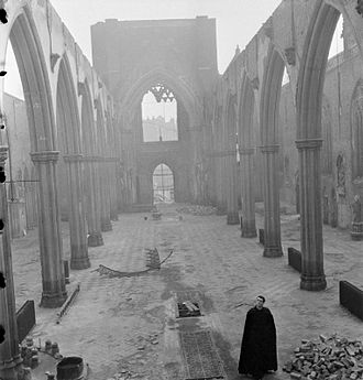 St George's Cathedral, Southwark - Catholic priest Father Dixon walks through the cathedral in 1942, after extensive damage was caused by incendiary bombing