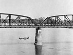 A Hawker Hurricane Mk IIC of No. 28 Squadron RAF flys alongside the Aya bridge, which spans the Irrawaddy River near Mandalay, Burma, during a low-level reconnaissance sortie, March 1945. C5108.jpg