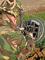 A Royal Air Force bomb disposal expert attaches a 'rocket wrench' to the tail of a 1000lb bomb during a training exercise MOD 45147757.jpg