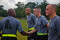 A U.S. Soldier assigned to the 114th Signal Battalion, 21st Signal Brigade congratulates a fellow Soldier following a battalion run at Fort Meade, Md., Aug. 10, 2012 120810-A-TV536-018.jpg