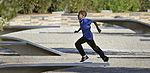 A boy runs at the Pentagon Memorial Sept 120911-D-NI589-158.jpg