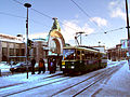 A tram in front of Helsinki station (enlightened).jpg