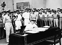 Admiral Sir Bruce Fraser signs the Japanese surrender document for Great Britain on board USS MISSOURI in Tokyo Bay, 2 September 1945. A30425.jpg