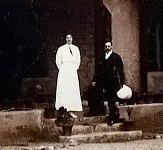 Aeneas Francon Williams - Williams (right, holding a hat) standing on the steps of Wolseley House, Kalimpong 1914