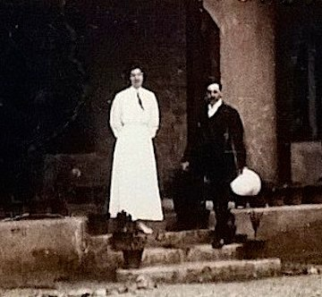 Aeneas Francon Williams (right, holding a hat) standing on the steps of Wolseley House, Kalimpong 1914
