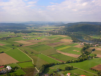 Hemishofen - Aerial view of the countryside, with the Rhine river on the right and Hemishofen in the background.