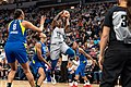 Alexis Jones shoots the ball against Aerial Powers and Liz Cambage in the Minnesota Lynx vs Dallas Wings game.jpg