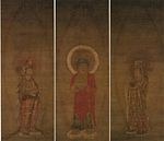A red robed deity flanked by two attendants.
