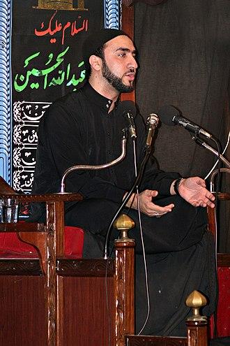 Minbar - Muslim scholar Ammar Nakshawani delivering a lecture from a minbar in Dar es Salaam's Hussainia as part of the Ramadan ceremonies.