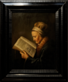 Amsterdam - Rijksmuseum 1885 - The Gallery of Honour (1st Floor) - Portrait of an old woman reading the Bible c. 1630-35 by Gerrit Dou.png