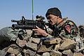 An Afghan National Army commando with the 1st Tolai, 3rd Special Operations Kandak provides security during a clearing operation in the Shah Wali Kot district of Kandahar province, Afghanistan, Nov. 11, 2013 131111-A-XP635-115.jpg