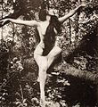 Annette Kellerman in tree, arms spread.jpg
