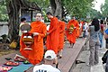 Another wave of monks comes by (14625184281).jpg