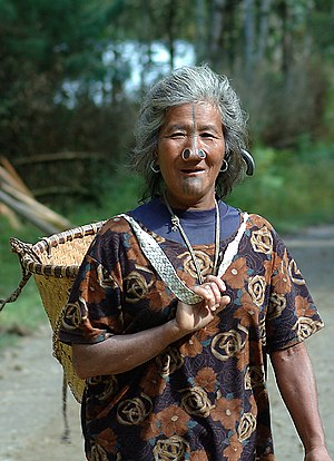 Apatani people - An Apatani woman with a basket going to field
