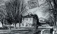 Via Roma e Villa Borromeo d'Adda, sullo sfondo, fotografia della fine del XIX secolo.