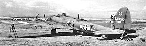 20th Bomb Squadron - Boeing B-17F-85-BO Fortress 42-30082 from the 20th Bomb Squadron undergoes maintenance in the open at Ain M'lila Airfield, Algeria in the late summer of 1943.