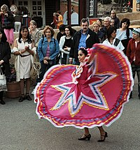 A Woman Dancing Folklórico In The Traditional Dress Of Jalisco