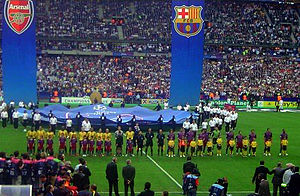 Arsenal F.C. and FC Barcelona line up before t...