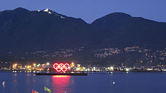 Barge with Olympic circles in Burrard Inlet, Vancouver, 2010.jpg