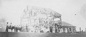 Barn raising - A barn raising, DeKalb County, Indiana, USA, about 1900
