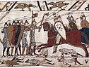 Part of the Bayeux Tapestry depicting Norman heavy cavalry charging Saxon shield wall