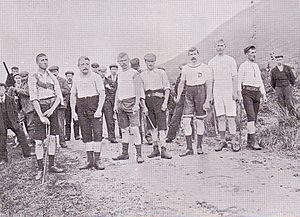 Ben Nevis Race - Runners line up for an early Ben Race. The starter is on left with a shotgun