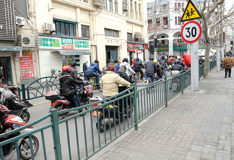 File:Bicycle and scooter commuters in Shanghai China.jpg
