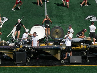 "Drum and bugle corps (modern) - The Bluecoats pit used thematic vocal amplification in their 2007 performance, ""Criminal."""