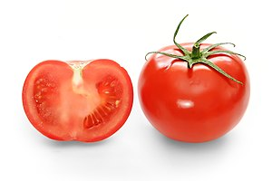 Tomato - Cross-section and full view of a hothouse (greenhouse-grown) tomato