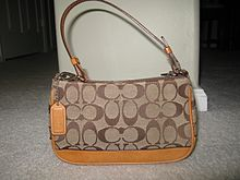 e8b0689424 Coach purse with the signature monogram C.