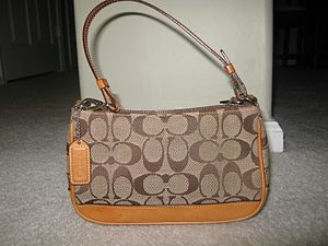Tapestry, Inc. - Coach purse with the signature monogram C.