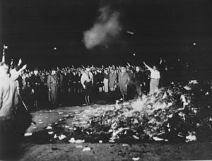 Book burning - Thousands of books smoulder in a huge bonfire as Germans give the Nazi salute during the wave of book-burnings that spread throughout Germany.
