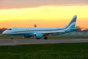 Embraer Lineage 1000 - on ramp, at sunrise