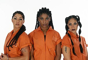 Women of Wrestling - Caged Heat, former WOW Tag Team Champions: (l-r) Vendetta, Delta Lotta Pain and Loca