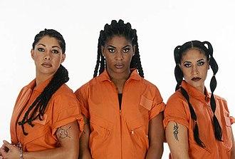 Women of Wrestling - Caged Heat, former WOW Tag Team Champions: (l-r) Vendetta, Delta Lotta Pain and Loca
