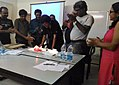 Celebration of fifty thousands images upload completion by wikipedian Biswarup Ganguli during West Bengal Wikimedians Strategy Meetup in KolkataP 20170806 125753 05.jpg