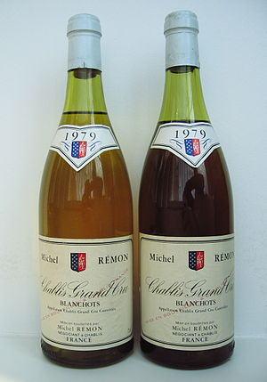 Bottle variation - Two bottles of the same Chablis Grand Cru wine showing considerable variation in colour at 30 years of age. The darker colour of the right-hand bottle indicates considerably more oxidation in this bottle. Since the fill level of this bottle is also slightly lower, a slightly faulty cork seal is likely the cause.