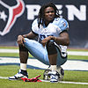 Chris Johnson sitting on his guard helmet at an American football game in 2010