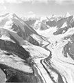 Chulitna Glacier, junction of multiple glaciers, with bergschrund on the upper portions of the mountain, August 1957 (GLACIERS 7171).jpg
