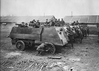 Armoured Autocar - Members of the Canadian Automobile Machine Gun Brigade clean their Armoured Autocars