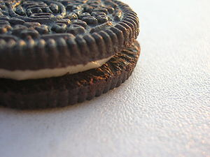 Photo of an Oreo cookie on a white table.