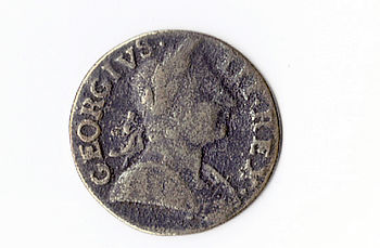 English: British half penny coin, King George III, dated 1775. This coin was given to me by my uncle Jack Prince, who said he purchased it from a flea market in Germany in the 1980. It may be a 'counterfiet' coin from that era, as the weight is only 6gms, and the diameter is 27mm. However, it appears to be copper, although it has a worn appearance, which may explain the loss of both weight and size from the original 9.2gms and 29-30 mm. It is an amazing 235 year old coin authentic or not.