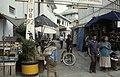 Collectie NMvWereldculturen, TM-20023925, Dia- Java, Semarang Toegangsweg naar stadskampong; op de achtergrond dak van de moskee. Rechts op de voorgrond bord met opschrift 17.8.92 (Indonesisch Onafhankelijksdag) ', Jaap de Jonge, 1993.jpg