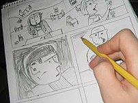 An artist sketching out a comics page