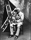 Confederate soldier & battle flag.jpg