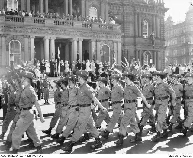 Corps troops with recent service in South Vietnam march past Sydney Town Hall