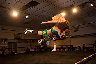 Rosemary (wrestler) - Courtney Rush (in green and yellow) hitting a spear.