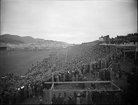 Crowd watching a rugby match at Athletic Park, Wellington, ca 1930.jpg
