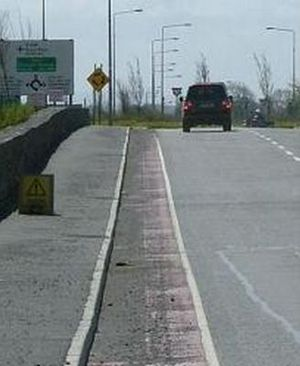 Road debris - Debris in Galway, Republic of Ireland on a lane reserved for non-motorized vehicles