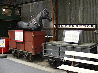 Mine railway - A preserved Dandy wagon of the Ffestiniog Railway. Before locomotives, slate trains would travel down to Porthmadog under gravity, and be pulled back up by horses